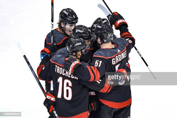 Justin Williams of the Carolina Hurricanes is congratulated by his teammates after scoring a goal at 917 against the Boston Bruins during the first...