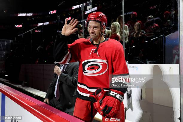 Justin Williams of the Carolina Hurricanes is named 1st star of the game and waves to fans after a victory over the Winnipeg Jets on January 21, 2020...