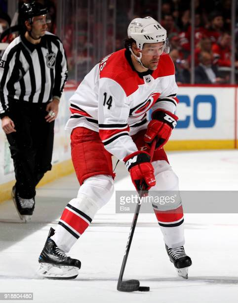 Justin Williams of the Carolina Hurricanes looks to pass against the New Jersey Devils on February 15 2018 at Prudential Center in Newark New...