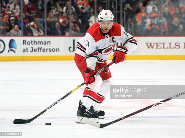 Justin Williams of the Carolina Hurricanes looks to pass the puck against the Philadelphia Flyers on April 6 2019 at the Wells Fargo Center in...