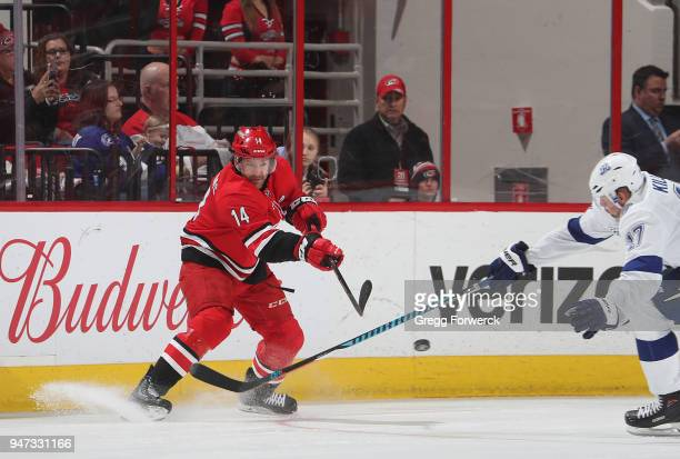 Justin Williams of the Carolina Hurricanes passes the puck passed the defense of Alex Killorn of the Tampa Bay Lightning during an NHL game on April...