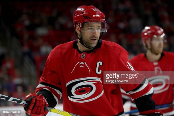 Justin Williams of the Carolina Hurricanes prepares for a faceoff during an NHL game against the Chicago Blackhawks on November 12 2018 at PNC Arena...