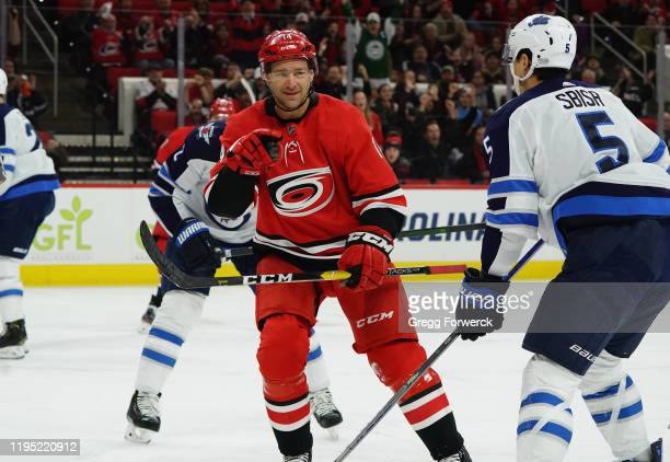 Justin Williams of the Carolina Hurricanes reacts after scoring a goal during an NHL game against the Winnipeg Jets on January 21, 2020 at PNC Arena...