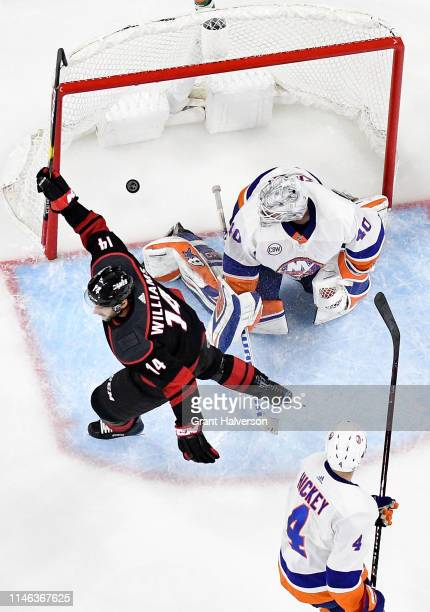 Justin Williams of the Carolina Hurricanes reacts after scoring the gamewinning goal against the New York Islanders during the third period of Game...