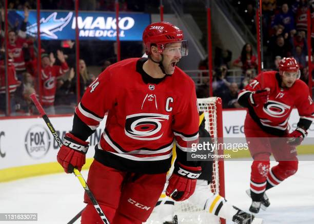 Justin Williams of the Carolina Hurricanes scores the game tying goal in regulation during an NHL game against the Pittsburgh Penguins on March 19,...