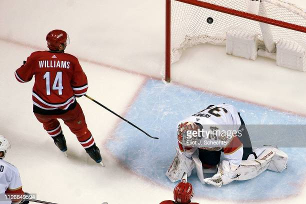 Justin Williams of the Carolina Hurricanes scores the game winning goal against Goaltender James Reimer of the Florida Panthers in the third period...