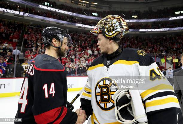 Justin Williams of the Carolina Hurricanes shakes hands with goaltender Tuukka Rask of the Boston Bruins following Game Four of the Eastern...