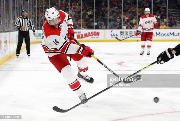 Justin Williams of the Carolina Hurricanes shoots the puck during the second period against the Boston Bruins in Game One of the Eastern Conference...