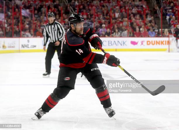 Justin Williams of the Carolina Hurricanes shoots the puck in Game Four of the Eastern Conference First Round against the Washington Capitals during...