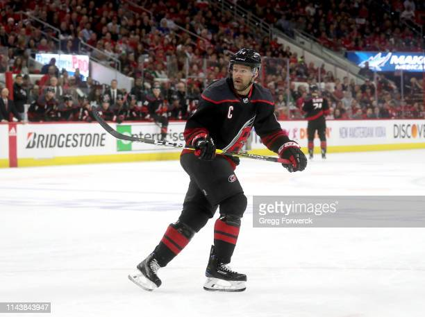 Justin Williams of the Carolina Hurricanes skates for position on the ice in Game Four of the Eastern Conference First Round against the Washington...