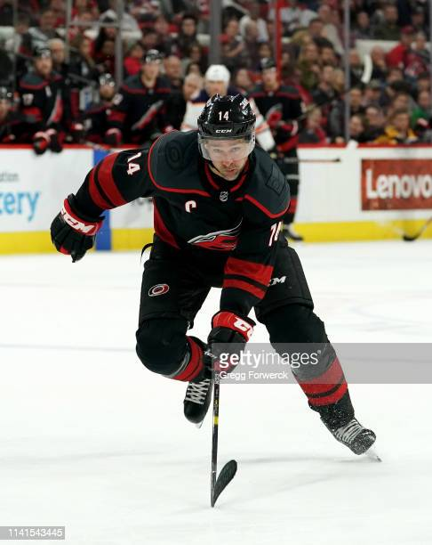 Justin Williams of the Carolina Hurricanes skates hard on the ice during an NHL game against the Edmonton Oilers on February 15, 2019 at PNC Arena in...