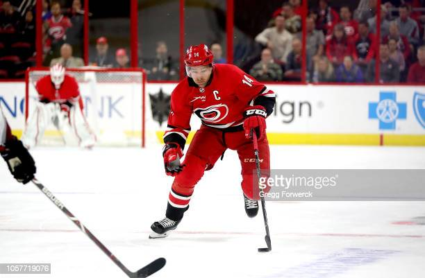 Justin Williams of the Carolina Hurricanes skates with the puck during an NHL game against the Colorado Avalanche on October 20 2018 at PNC Arena in...