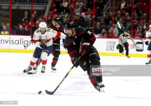 Justin Williams of the Carolina Hurricanes skates with the puck during an NHL game against the Florida Panthers on November 23, 2018 at PNC Arena in...