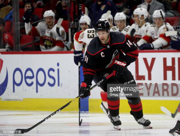 Justin Williams of the Carolina Hurricanes skates with the puck during an NHL game against the Florida Panthers on November 23 2018 at PNC Arena in...