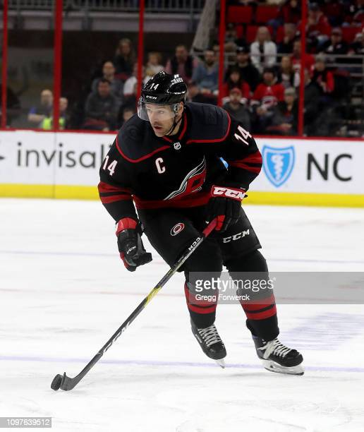 Justin Williams of the Carolina Hurricanes skates with the puck during an NHL game against the Ottawa Senators on January 18 2019 at PNC Arena in...