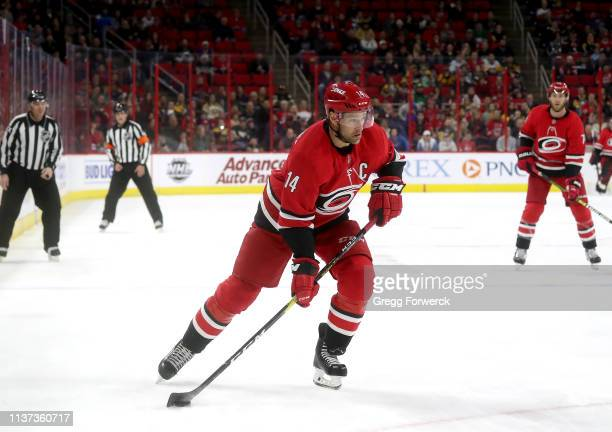 Justin Williams of the Carolina Hurricanes skates with the puck during an NHL game against the Pittsburgh Penguins on March 19 2019 at PNC Arena in...
