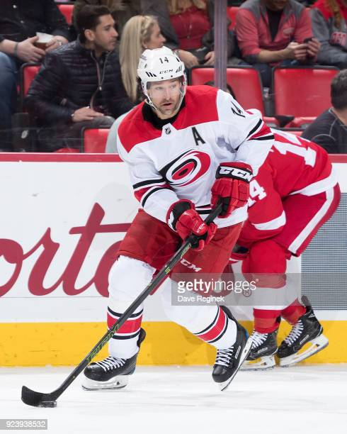 Justin Williams of the Carolina Hurricanes skates with the puck during an NHL game against the Detroit Red Wings at Little Caesars Arena on February...