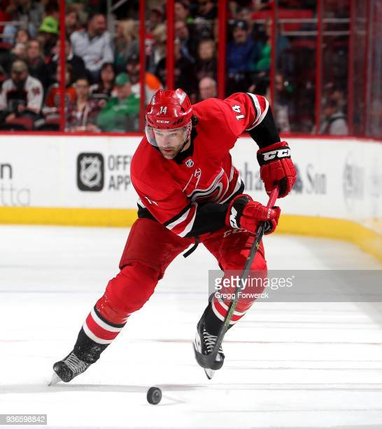 Justin Williams of the Carolina Hurricanes skates with the puck during an NHL game against the Philadelphia Flyers on March 17 2018 at PNC Arena in...