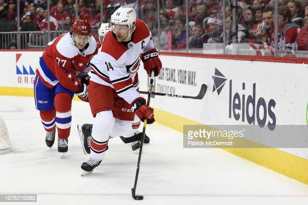 Justin Williams of the Carolina Hurricanes skates with the puck in the third period against the Washington Capitals at Capital One Arena on December...