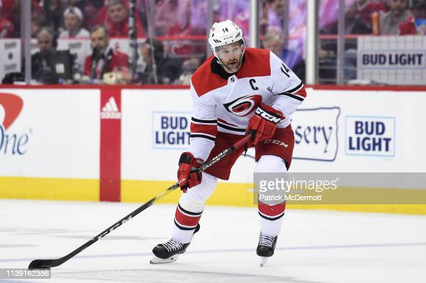Justin Williams of the Carolina Hurricanes skates with the puck in the second period against the Washington Capitals in Game Seven of the Eastern...