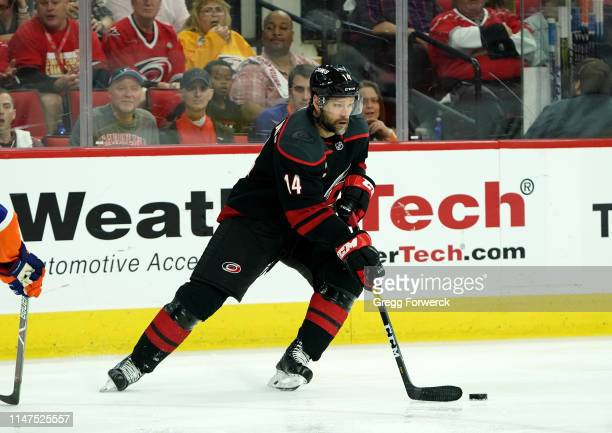 Justin Williams of the Carolina Hurricanes skates with the puck in Game Four of the Eastern Conference Second Round against the New York Islanders...