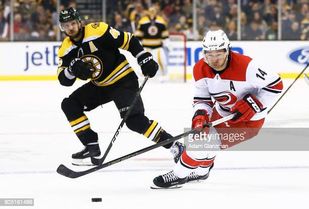 Justin Williams of the Carolina Hurricanes skates with the puck in the third period of a game against the Boston Bruins at TD Garden on February 27...