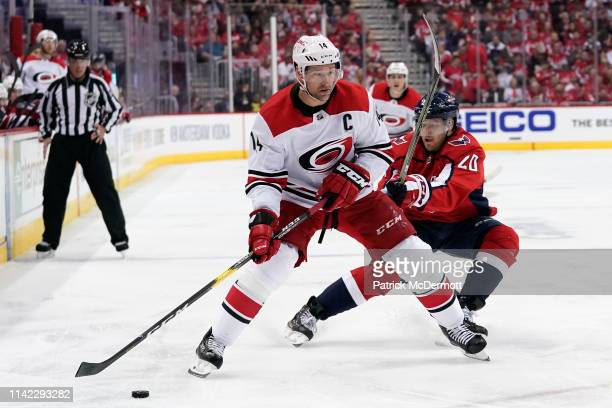 Justin Williams of the Carolina Hurricanes skates with the puck against Lars Eller of the Washington Capitals in the second period in Game One of the...