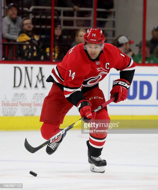 Justin Williams of the Carolina Hurricanes skates with the puck on the ice during an NHL game against the Boston Bruins on October 30 2018 at PNC...