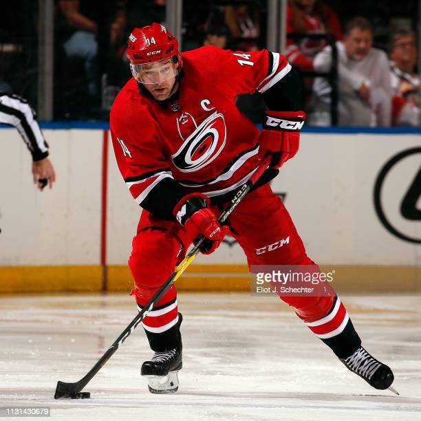 Justin Williams of the Carolina Hurricanes skates with the puck against the Florida Panthers at the BBT Center on February 21 2019 in Sunrise Florida