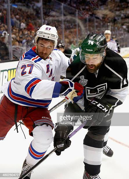 Justin Williams of the Los Angeles Kings battles with Ryan McDonagh of the New York Rangers during overtime of Game Two of the 2014 Stanley Cup Final...
