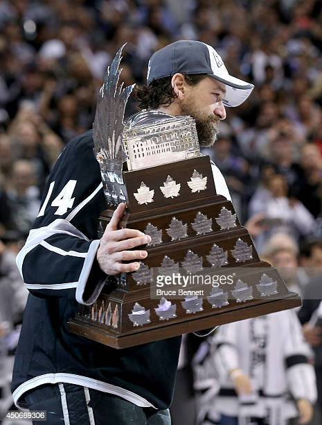 Justin Williams of the Los Angeles Kings celebrates after winning the Conn Smythe Trophy after the Kings 3-2 double overtime victory against the New...