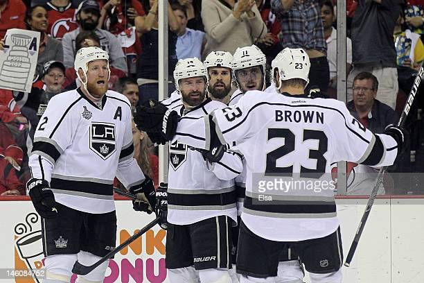 Justin Williams of the Los Angeles Kings celebrates with Matt Greene, Willie Mitchell, Anze Kopitar and Dustin Brown after Williams scores a goal in...