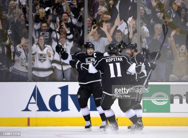 Justin Williams of the Los Angeles Kings celebrates with teammates Anze Kopitar and Dustin Brown after Williams scores a first period goal against...