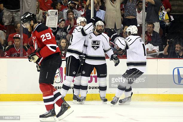 Justin Williams of the Los Angeles Kings celebrates with teammates Willie Mitchell and Anze Kopitar after scoring in the second period as Mark Fayne...