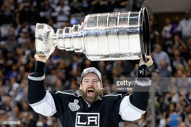 Justin Williams of the Los Angeles Kings celebrates with the Stanley Cup after the Kings 3-2 double overtime victory against the New York Rangers in...