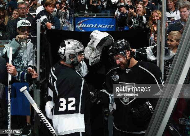 Justin Williams of the Los Angeles Kings congratulates goaltender Jonathan Quick after the Kings defeated the New York Rangers 54 with an overtime...