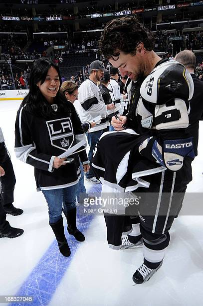 Justin Williams of the Los Angeles Kings gives his jersey to a fan following the game against the San Jose Sharks at Staples Center on April 27 2013...