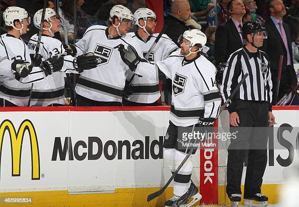 Justin Williams of the Los Angeles Kings is congratulated by teammates a goal against the Colorado Avalanche at the Pepsi Center on March 10 2015 in...