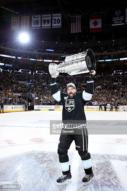 Justin Williams of the Los Angeles Kings of the Los Angeles Kings celebrates with the Stanley Cup after the Kings 3-2 double overtime victory against...