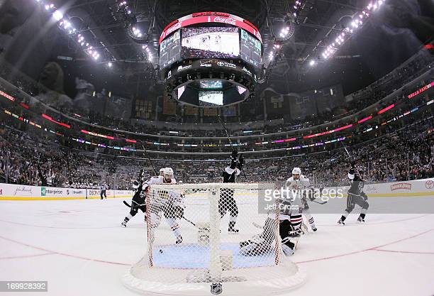 Justin Williams of the Los Angeles Kings reacts after scoring against goaltender Corey Crawford of the Chicago Blackhawks in the first period of Game...