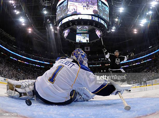 Justin Williams of the Los Angeles Kings reacts as teammate Dwight King scores a second period goal past goaltender Brian Elliott of the St. Louis...