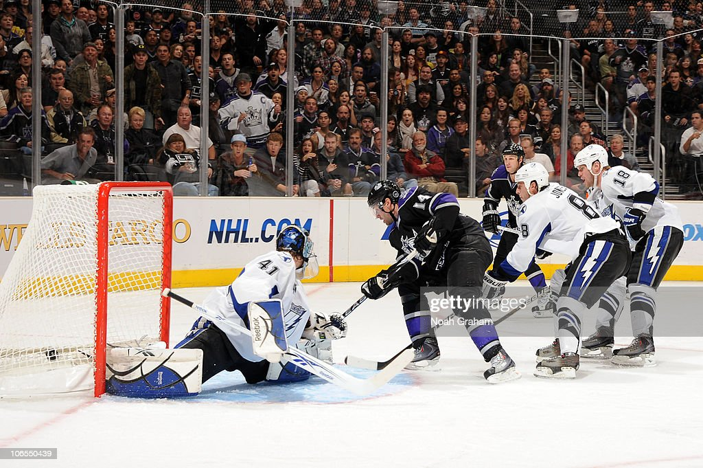Justin Williams #14 of the Los Angeles Kings shoots and scores the game winning goal against Mike Smith #41 of the Tampa Bay Lightning at Staples Center on November 4, 2010 in Los Angeles, California.