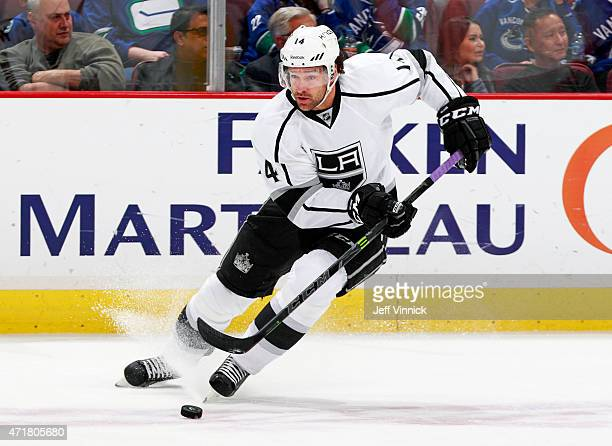 Justin Williams of the Los Angeles Kings skates up ice with the puck during their NHL game against the Vancouver Canucks at Rogers Arena April 6,...