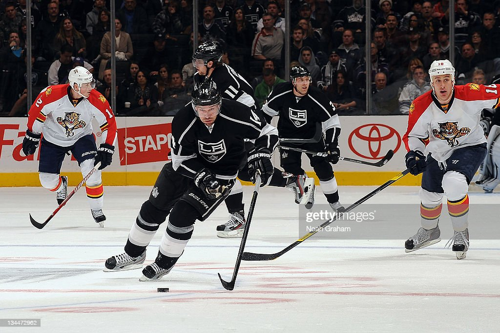 Justin Williams #14 of the Los Angeles Kings skates with the puck against the Florida Panthers at Staples Center on December 1, 2011 in Los Angeles, California.
