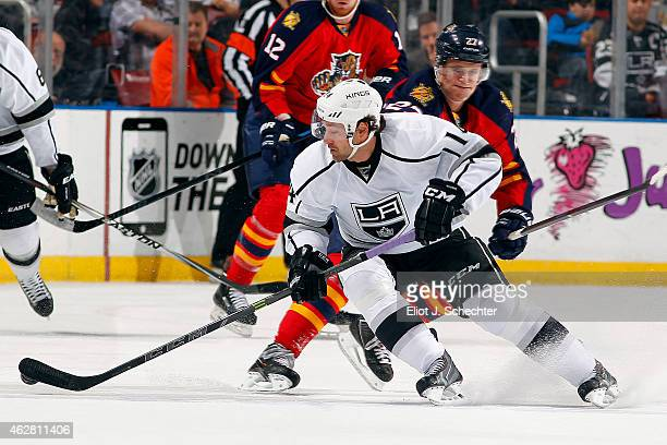 Justin Williams of the Los Angeles Kings skates with the puck against Nick Bjugstad of the Florida Panthers at the BBT Center on February 5 2015 in...