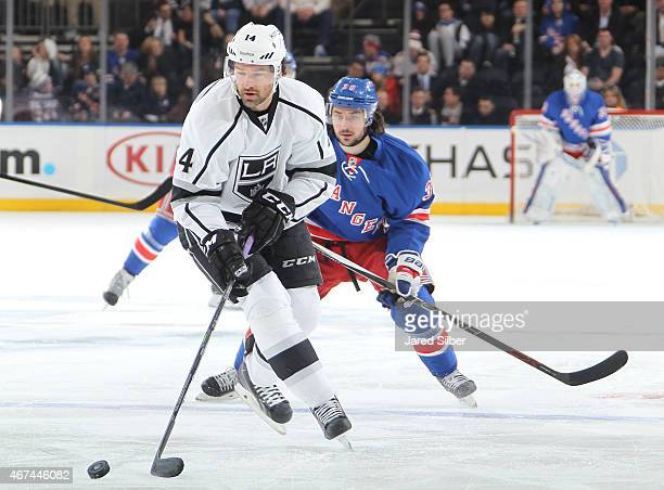 Justin Williams of the Los Angeles Kings skates with the puck against Mats Zuccarello of the New York Rangers at Madison Square Garden on March 24...