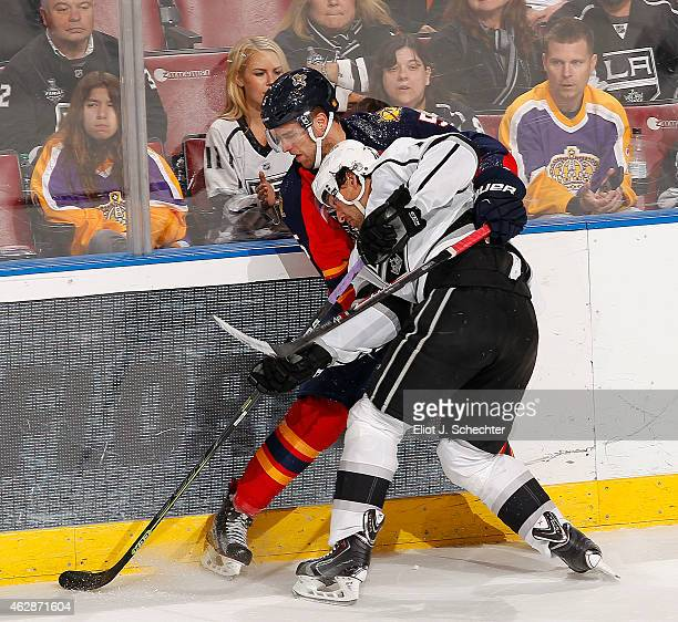 Justin Williams of the Los Angeles Kings tangles with Aaron Ekblad of the Florida Panthers at the BBT Center on February 5 2015 in Sunrise Florida
