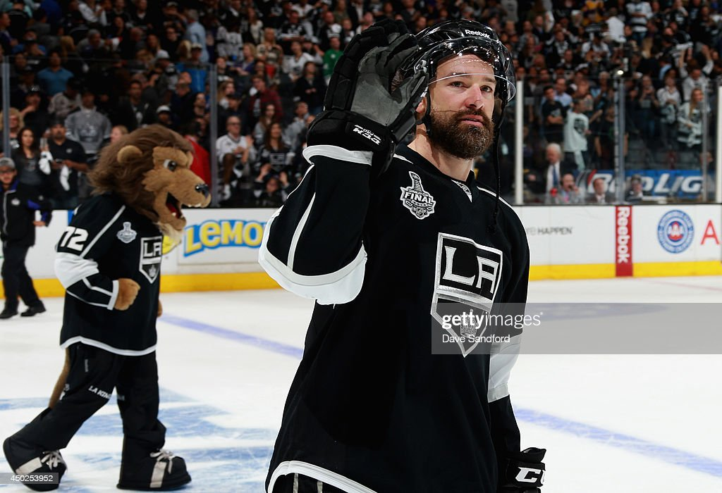 Justin Williams #14 of the Los Angeles Kings waves to the crowd after the Kings defeated the New York Rangers 5-4 with an overtime goal scored by Dustin Brown #23 (not pictured) in Game Two of the 2014 Stanley Cup Final at Staples Center on June 7, 2014 in Los Angeles, California.