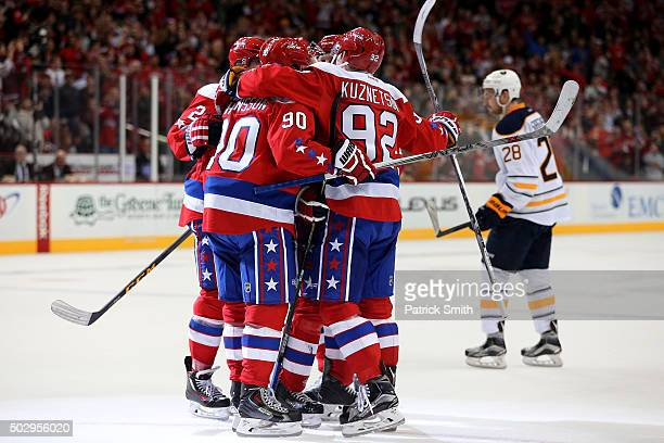 Justin Williams of the Washington Capitals celebrates a second period goal with teammates against the Buffalo Sabres at Verizon Center on December 30...