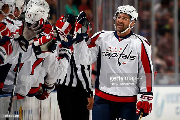 Justin Williams of the Washington Capitals celebrates his first goal of the season with teammate during the first period against the Florida Panthers...
